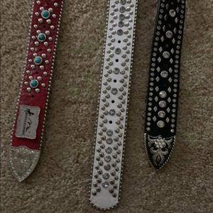 Three women western belts.